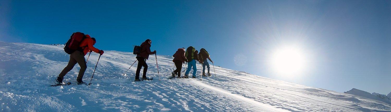 Hike and Fly mit Schneeschuhen und Tandem-Gleitschirm